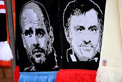 10 December 2017 -  Premier League - Manchester United v Manchester City - Scarves bearing images of Josep Guardiola and Jose Mourinho - Photo: Marc Atkins/Offside