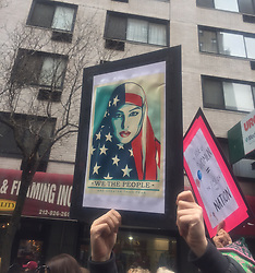 """NEW YORK, USA - Saturday, January 21, 2017: A woman holds up a banner """"We The People are greater than fear"""" as thousands of people take part in the Women's March on January 21, 2017 in New York City. The Midtown Manhattan event was one of many anti-Trump protests nationwide that came a day after Donald Trump was sworn in as the 45th President of the United States. (Pic by Concepcion Valadez/Propaganda)"""