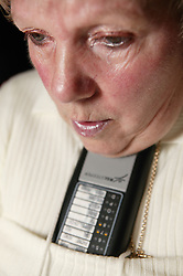 Woman at home using a chin operated remote control,
