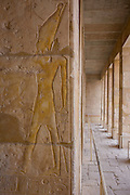 "Hieroglyphs on columns at the ancient Egyptian Temple of Hatshepsut near the Valley of the Kings, Luxor, Nile Valley, Egypt. The Mortuary Temple of Queen Hatshepsut, the Djeser-Djeseru, is located beneath cliffs at Deir el Bahari (""the Northern Monastery""). The mortuary temple is dedicated to the sun god Amon-Ra and is considered one of the ""incomparable monuments of ancient Egypt."" The temple was the site of the massacre of 62 people, mostly tourists, by Islamists on 17 November 1997."