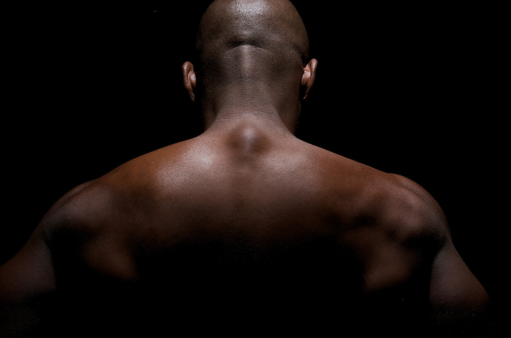 Close up of a worked out back of an African American Young.