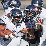 11/5/16 2:17:01 PM Fullerton Hornet running back Anthony Wood (8) attempts to avoid the tackle of Orange Coast Pirate linebacker Michael Archer (49) during the second quarter. Fullerton College v Orange Coast College Football, at LeBard Stadium on the campus of Orange Coast College in Costa Mesa, CA<br /> <br /> Photo by Joshua D. McKee