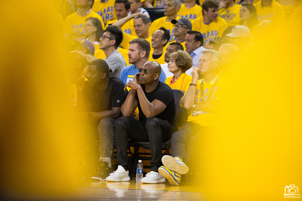 Comedian Dave Chappelle watches the Golden State Warriors host the Utah Jazz during Game 1 of the Western Conference Semifinals at Oracle Arena in Oakland, Calif., on May 2, 2017. (Stan Olszewski/Special to S.F. Examiner)