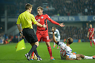Marc Albrighton of Leicester City argues with the linesmen after a tussle with Karl Henry of Queens Park Rangers. Barclays Premier league match, Queens Park Rangers v Leicester city at Loftus Road in London on Saturday 29th November 2014.<br /> pic by John Patrick Fletcher, Andrew Orchard sports photography.