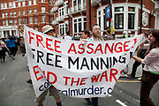 """London, UK. Thursday 16th August 2012. Supporters of Julian Assange outside the Ecuador Embassy with a banner reading """"Free Assange, Free Manning, End the War""""."""