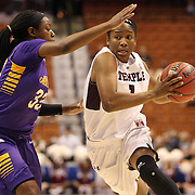Erica Covile, (right), Temple, drives past Janesha Ebron, East Carolina, during the Temple Vs East Carolina Quarterfinal Basketball game during the American Women's College Basketball Championships 2015 at Mohegan Sun Arena, Uncasville, Connecticut, USA. 7th March 2015. Photo Tim Clayton