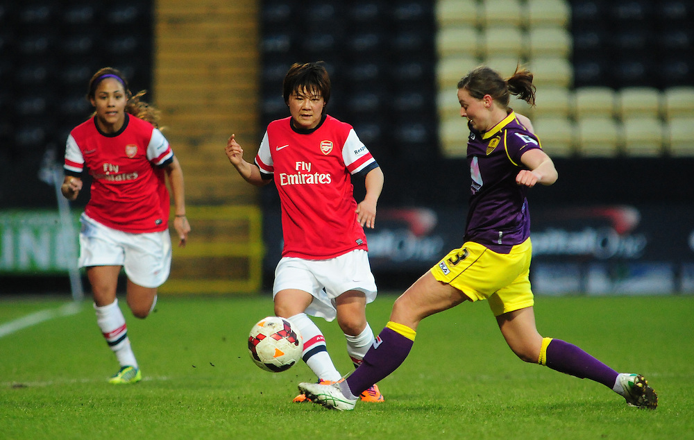 Arsenal Ladies's Shinobu Ohno feeds the ball past Notts County Ladies's Anna Green<br /> <br /> Photo by Chris Vaughan/CameraSport<br /> <br /> Women's Football - FA Women's Super League 1 - Notts County Ladies v Arsenal Ladies - Wednesday 16th April 2014 - Meadow Lane - Nottingham<br /> <br /> © CameraSport - 43 Linden Ave. Countesthorpe. Leicester. England. LE8 5PG - Tel: +44 (0) 116 277 4147 - admin@camerasport.com - www.camerasport.com
