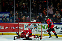 KELOWNA, BC - DECEMBER 30:  Michael Farren #16 of the Kelowna Rockets celebrates a overtime game winning goal on Taylor Gauthier #35 of the Prince George Cougars at Prospera Place on December 30, 2019 in Kelowna, Canada. (Photo by Marissa Baecker/Shoot the Breeze)