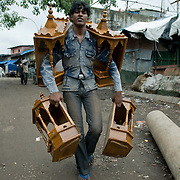 Window display, Dharavi style. Wooden shrines being carried out of dharavi to be sold to Hidnu homes in Mumbai.