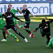 Werder Bremen's Assani Lukimya (2ndL) during their Tuttur.com Cup Final soccer match Werder Bremen between Werder Bremen v Vfl Wolfsburg at Mardan stadium in Antalya Turkey on 09 Wednesday January, 2013. Photo by Aykut AKICI/TURKPIX