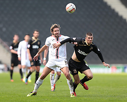 MK Dons forward Alan Smith (11) and Crawley Town forward Jamie Proctor (14) challenge for the ball  - Photo mandatory by-line: Nigel Pitts-Drake/JMP - Tel: Mobile: 07966 386802 12/04/2014 - SPORT - FOOTBALL -  Stadium MK - Milton Keynes - Milton Keynes Dons v Crawley Town - Sky Bet League One