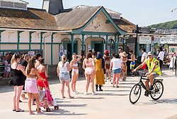 © Licensed to London News Pictures;30/05/2020; Weston-super-Mare UK. People queue while trying to maintain social distance in hot sunny weather on the beach and promenade at the seaside in Weston-super-Mare, on the last weekend before some more restrictions under the coronavirus lockdown are to be eased by the Government. From Monday groups of up to 6 people from different households will be able to meet outside but must maintain social distancing to prevent the spread of the Covid-19 virus. There has been an outbreak of Covid-19 at Weston General Hospital which has now been traced to an accommodation block inside the hospital grounds. The outbreak had been blamed on visitors to Weston coming from outside the area. Photo credit: Simon Chapman/LNP.