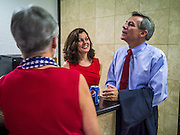 28 AUGUST 2012 - PHOENIX, AZ: Rep. DAVID SCHWEIKERT (R-AZ), right, and his wife, JOYCE SCHWEIKERT, talks to a supporter at Schweikert's victory party Tuesday. Schweikert faced Congressman Ben Quayle in what was the hardest Republican primary election in Arizona in 2012. Both were incumbent Republican freshmen elected to Congress from neighboring districts in 2010. They ended up in the same district at the end of the redistricting process and faced off against each other in the primary to represent Arizona's 6th Congressional District, which is made up of Scottsdale, Paradise Valley and parts of Phoenix. The district is solidly Republican and the winner of the primary is widely expected to win November's general election. Both are conservative Republicans with Tea Party backing.    PHOTO BY JACK KURTZ