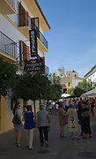 People gather in the village of Zahara de la Sierra, Spain Sunday 13 October 2013 after the National Day holiday