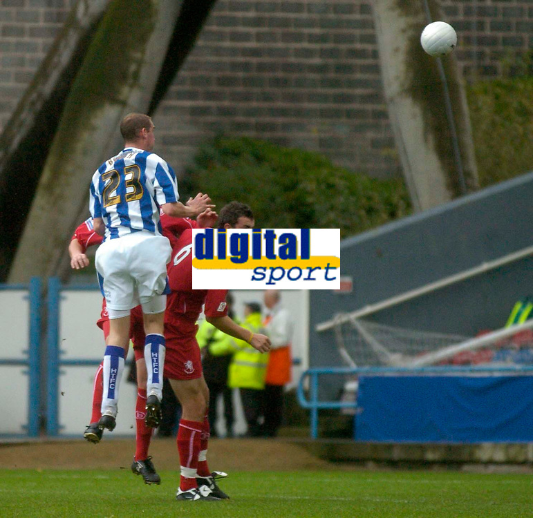 Photo: Glyn Thomas.<br />Huddersfield Town v Welling United. The FA Cup. 06/11/2005.<br />Huddersfield's Andrew Booth (L) heads his team into a 1-0 lead.