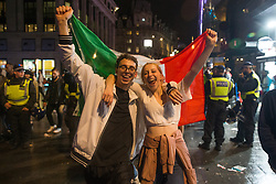 © Licensed to London News Pictures.  12/07/2021. London, UK. Italian football fans celebrate their victory in Leicester Square, central London as England lose to Italy on penalties during the EURO 2020. Photo credit: Marcin Nowak/LNP
