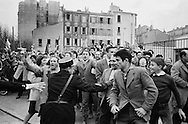1960.Marseille,<br /> A friendly crowd of French communists<br /> breaks through security causing major<br /> panic with Khrushchev's security men<br /> as they were not prepared for a joyous outpouring such as this. They rushed Khruschev in the first car they could find and was send off. <br /> NOTE: The Russian journalists and photographers who were with us, turned around and acted as temporary bodyguards,a very unusual <br /> happening.<br /> <br /> 1960. Marseille, France<br /> Une foule amicale des communistes français perce la sécurité causant une<br /> panique chez les hommes de la sécurité de Khrouchtchev, mal préparés pour une effusion de joie comme celle-ci . Ils ont précipités Khruschev dans la première voiture qu'ils ont pu trouver sont partis. <br /> NOTE : Les journalistes russes et les photographes qui étaient avec nous , se sont retournes et ont agis comme gardes du corps temporaires, une fonction très inhabituel pour eux.