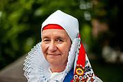 """Portrait of Monika Ofner-Reim in a traditional Sudeten Germans dress. She belongs to the community """"Wischauer Sprachinsel""""  (Gemeinschaft Wischauer Sprachinsel) which keeps the traditions from the past alive. Photographed during the 71st Sudeten German meeting at the """"Philharmonie im Gasteig"""" in Munich."""