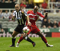 Photo. Glyn Thomas. <br /> Newcastle United v Hapoel Bnei Sakhnin. <br /> UEFA Cup, 1st round, 1st leg. 16/09/2004.<br /> Newcastle's Stephen Carr (L) battles for the ball with Alain Ekekanga Masudi<br /> NORWAY ONLY