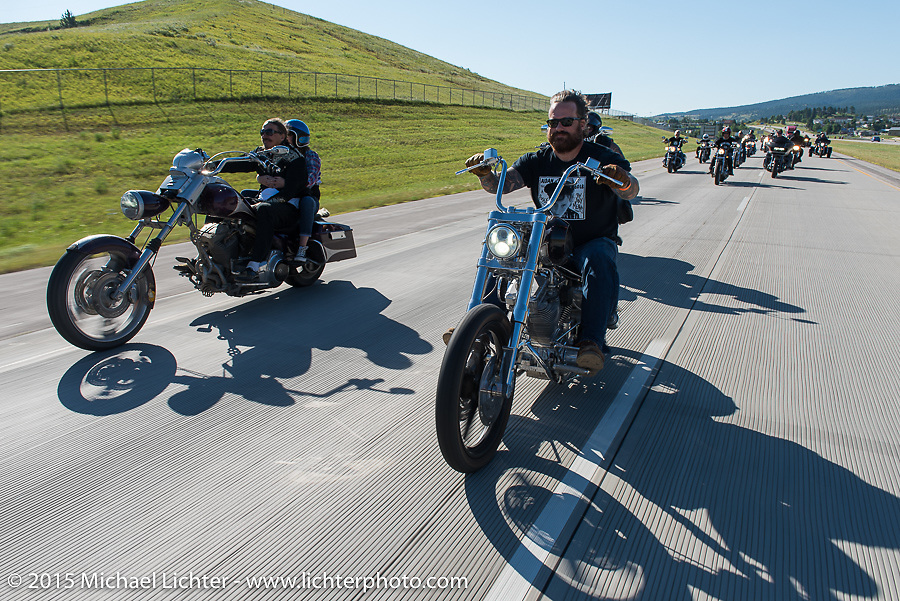 Bobby Seeger Jr rides beside Bean're on Aiden's Ride, dedicated to help raise awareness for ALD after Bobby Seeger Jr. of Indian Larry Motorcycles' son passed away from the disease, during the 75th Annual Sturgis Black Hills Motorcycle Rally.  SD, USA.  August 6, 2015.  Photography ©2015 Michael Lichter.