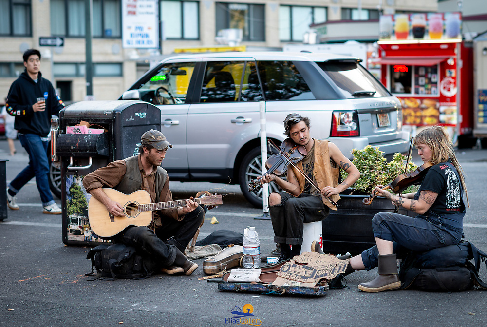 Street performers playing music on the streets of Portland. Oregon.