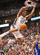Jazz guard Alec Burks (10) slam dunks the ball during the first half of the NBA basketball game between the Utah Jazz and the Golden State Warriors at Energy Solutions Arena, Wednesday, Dec. 26, 2012.