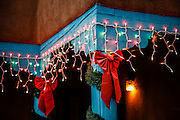 SHOT 12/29/15 6:06:52 PM - Christmas lights adorn an adobe along Ledoux Street in Taos, N.M. to celebrate the season. Taos, N.M. is a town in northern New Mexico's high desert, bounded by the Sangre de Cristo Mountains and incorporated in 1934 with a population of around 6,000. It's known for historic adobe buildings like Taos Pueblo, a multistory adobe complex inhabited by Native Americans for centuries. A longtime artist colony, Taos also offers many galleries and museums showcasing regional artwork. (Photo by Marc Piscotty / © 2015)