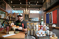Jose Torres shows a Grande Fromage sandwich at La Fromage du Femme eatery at the East End Market, in Orlando, Fla., Thursday, Feb. 2, 2017. (Phelan M. Ebenhack via AP)