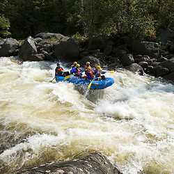 Whitewater rafting Dragon's Tooth rapid on the Deerfield River in Rowe, Massachusetts.  Dryway run.  Class IV.