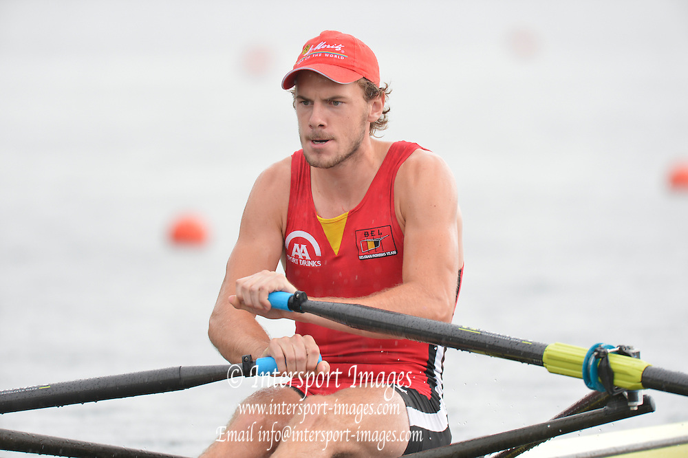 Trackai. LITHUANIA.  BEL BM1X, Hannes OBRENO waits in the rain for the start of his heat, Start, Heats. 2012 FISA U23 Rowing Championships, Lake Galve.   13:28:01 Thursday 12/07/2012 [Mandatory credit: Peter Spurrier/Intersport Images]..Rowing, U23, 2012.