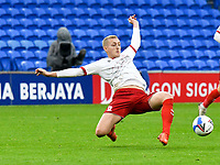 Football - 2020 / 2021 Sky Bet Championship - Cardiff City vs Middlesbrough - Cardiff City Stadium<br /> <br /> George Saville of Middlesbrough defends  watched by referee Mr  J Brooks<br /> in a match played without fans<br /> <br /> COLORSPORT