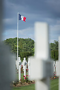 White crosses and French flag at World War One cemetery, Douaumont Ossuary, Verdun, France