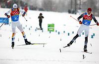 OL 2006 Langrenn menn stafett,<br />Pragelato Plan<br />19..02.06 <br />Foto: Sigbjørn Hofsmo, Digitalsport <br /><br />Mathias Fredriksson SWE - Tobias Angerer GER