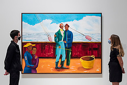"""© Licensed to London News Pictures. 07/09/2021. LONDON, UK. Staff members view """"The Captain and The Mate"""", 2017-18, by Lubaina Himid. Preview of 'Mixing It Up: Painting Today', a group new exhibition at the Hayward Gallery which highlights the UK's emergence as a vital international centre of contemporary painting with works by 31 artists on display.  The show runs 9 September to 12 December.  Photo credit: Stephen Chung/LNP"""
