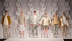 © Licensed to London News Pictures. 01/06/2014. London, England. Collection by Samantha Bartle from the Manchester School of Art. Graduate Fashion Week 2014, Runway Show at the Old Truman Brewery in London, United Kingdom. Photo credit: Bettina Strenske/LNP