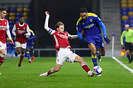 AFC Wimbledon defender Terell Thomas (6) battles for possession with Arsenal midfielder Ben Cottrell (41) during the EFL Trophy match between AFC Wimbledon and U21 Arsenal at Plough Lane, London, United Kingdom on 8 December 2020.