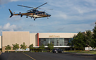 Gov. Bobby Jindal's helicopter leaves the parking lot of The Grand 16 cinema in  Lafayette Louisiana, - after a press conference where Jindal gave a rant about why now is not the right time to talk about gun control, in gory detail he described his walk through of the crime seen. It could have been his kids inside, he said.