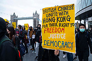 Hundreds of Hongkongers  protest at Londons City Hall in support of pro-democracy protests in Hong Kong on 5th October, 2019 in London, United Kingdom. The demonstrators have been protesting since June when Hong Kongs  Chief executive Carrie Lam tried to pass into law the Extradition Bill. Yesterday a ban on face mask was implemented. Demonstrators ask the international community to help safeguard Hong Kongs democratic rights.