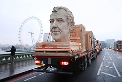 EDITORIAL USE ONLY<br /> Three 8 foot models of the heads of The Grand Tour presenters, Jeremy Clarkson, James May and Richard Hammond travel through Westminster in London on the back of flatbed trucks after travelling 30,000 miles across 3 continents.