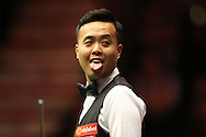 Marco Fu (HK) reacts as he checks the scoreboard. Marco Fu (HK) v Mark Allen (NI) , Quarter-Final match at the Dafabet Masters Snooker 2017, at Alexandra Palace in London on Thursday 19th January 2017.<br /> pic by John Patrick Fletcher, Andrew Orchard sports photography.