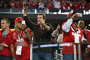 Ohio State Buckeyes fans take photos while their team takes the field to warmup before kickoff against the Oregon Ducks at the College Football Playoff National Championship Game at AT&T Stadium on January 12, 2015 in Arlington, Texas.  (Cooper Neill for The New York Times)