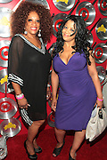 """September 18, 2012- Harlem, New York: (L-R) Recording Artist/Civil rights Activist Kathy Sharpton and Public Relations Expert Nina Flowers at Sylvia's Restaurant 50th Anniversary Golden Jubliee Gala celebrating the life and legacy of the late Sylvia Woods and held at Sylvia's Restaurant on September 18, 2012 in the Village of Harlem, USA. The 50th Anniversary Gala salutes Sylvia's as """"the world's kitchen"""" and celebrates a legend of the historic Harlem community. With an invite-only fundraising event for 500+ guests, the night kicked-off with a lavish cocktail hour and live performances from Sylvia's A-list guests, many of whom have made Sylvia's a home away from home for the past 5 decades. (Terrence Jennings)"""