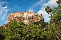 Sigiriya, or Lion's rock, is an ancient rock fortress and palace ruin surrounded by the remains of an extensive network of gardens. Sigiriya is also renowned for its ancient fresco paintings which are reminiscent of the Ajanta Caves of India.  Sigiriya was built during the reign of King Kassapa I and it is one of the seven World Heritage Sites of Sri Lanka.  The Sigiriya rock is a hardened magma plug from an extinct and long-eroded volcano. It stands high above the surrounding plain, visible for miles in all directions.