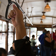 Riders on San Francisco's electric trolley.