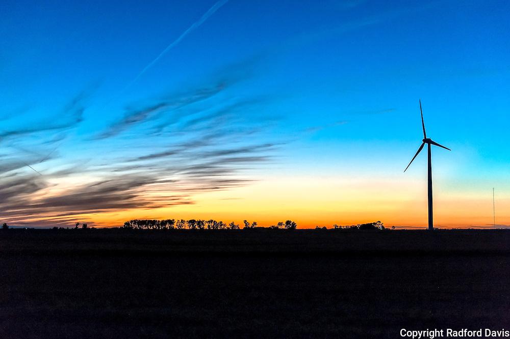 Iowa sunset and wind mill