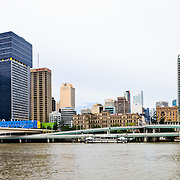 High resolution panorama of Brisbane city skyline as viewed from Southbank across the Brisbane River, with the distinctive Riverside Expressway