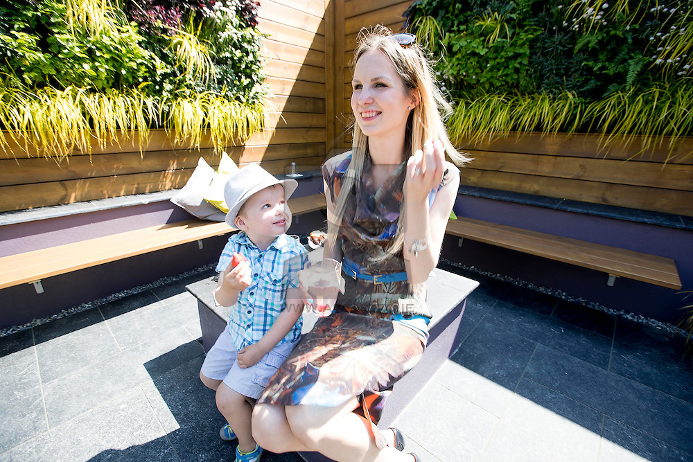 REPRO FREE: 01/06/2016 Ryan Brophy (age 3) from Dublin pictured exploring the Chef garden with creator, 21 year old Sofi Dosa, the youngest ever garden designer to compete at Bloom in the Park. Her saucy design, entitled 'Blurred Lines', contains a beautiful living wall of tomato plants – the key ingredient in Chef Tomato Ketchup. <br /> <br /> The garden is using locally sourced Irish-only materials such as Kilkenny limestone and a variety of Wicklow planting – tying in with the fact that Chef Ketchup is made in Cabra, Dublin, just down the road from the Phoenix Park. Sofi's garden also includes a fire pit and a seating area for 10 people, making it perfect for a saucy summer barbecue! <br /> <br /> Anyone visiting Bloom this weekend is invited to visit the 'Chef Summer Shake-Up' stand where barbeque pods will be treating visitors to a range of flavoursome barbeque food – so they can experience first-hand why Chef Tomato Ketchup really does make tasty tastier! <br /> A host of cooking demonstrations will also take place, with experienced and entertaining chefs offering top tips and hints on how to create the best barbeque possible. There will also be a DJ and a selection of large scale games including Connect 4 and Chef Bowling to ensure lots of family fun. Picture Andres Poveda<br /> <br /> Follow Chef Ireland on Facebook and Twitter for more information on Chef at Bloom 2016 and<br /> how Chef makes tasty tastier! <br /> Picture Andres Poveda<br /> ENDS<br /> <br /> For further information, please contact: <br /> Catherine Quinn / Niall McHugh<br /> Unique Media<br /> Tel: 01 5225200 / 086 8632182 (CQ)