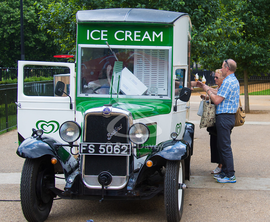 London, June 2nd 2017.  A couple buy ice creams in Hyde Park as clouds build up ahead of forecast thunderstorms.