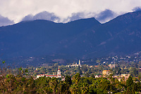 Chuches and the Santa Barbara Mission (on right) with Santa Ynez Mountains behind, Santa Barbara, California USA.
