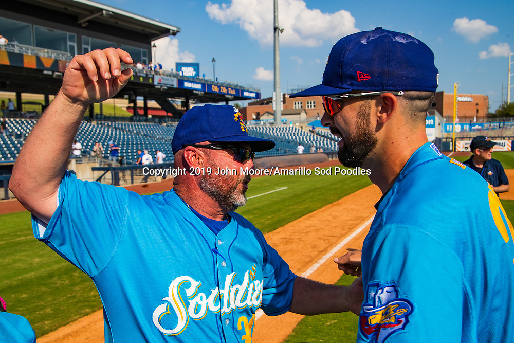Amarillo Sod Poodles Manager Phillip Wellman and Amarillo Sod Poodles pitcher Jesse Scholtens (38) celebrates after the Sod Poodles won against the Tulsa Drillers during the Texas League Championship on Sunday, Sept. 15, 2019, at OneOK Field in Tulsa, Oklahoma. [Photo by John Moore/Amarillo Sod Poodles]